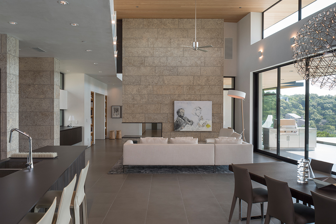 Contemporary living room limestone floating fireplace
